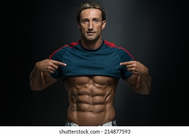 Perfect Abs - Portrait Of A Physically Fit Muscular Middle Age Man Without A Shirt
