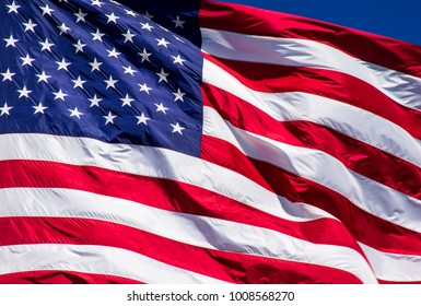 Perfect American Flag with perfect waves with a small corner of perfect blue sky. A patriotic national flag that stands for freedom