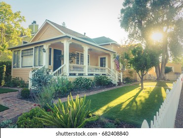 Perfect American Suburban White Picket Fence Home With Veranda And Flag