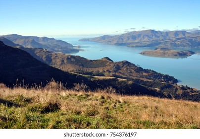 A perfect Autumn day overlooking Lyttelton Harbour from the top of the Port Hills. Christchurch, New Zealand. On the left is the port of Lyttelton.
