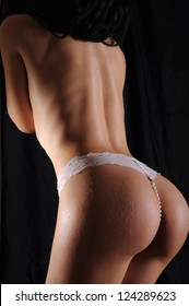 Perfect back of a sexy woman wearing a white thong