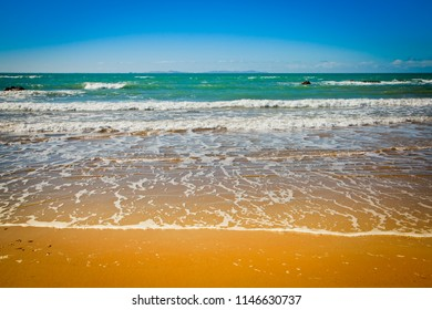 Perfect Beach, Gentle waves caress shore of golden sand. Holiday dreaming. Space for copy.