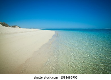 Perfect Beach, Sun-soaked sand kissed by gentle waves of the turquoise ocean and coral reef.. Nature Bay, Gnaraloo, Ningaloo reef, Western Australia.