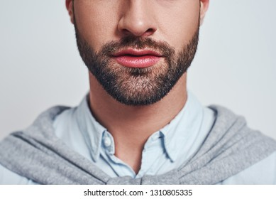 Perfect beard. Close-up cropped image of a handsome young man with a beard. Man beauty