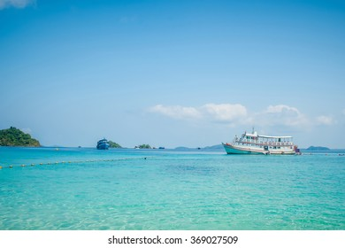 Perfect beautiful paradise beach, boat and tourists at Koh Chang Island in Thailand
