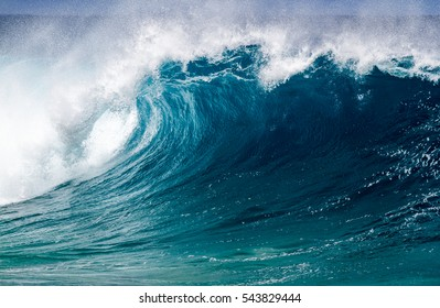 A Perfect big breaking Ocean barrel wave on the north shore of Oahu Hawaii
