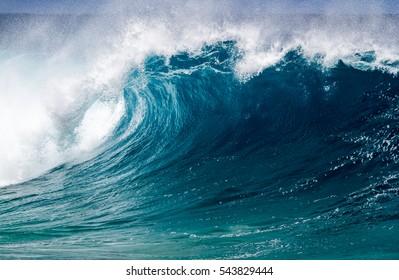 A Perfect big breaking Ocean barrel wave on the north shore of Oahu Hawaii