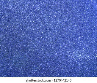 Perfect blue background with many glittering glitter effect ideal as a backdrop