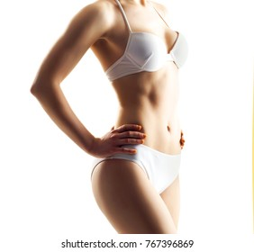 Perfect body of slim, fit and sporty girl in underwear isolated on white.