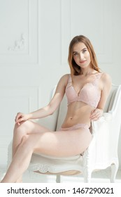 Perfect body young woman in underwear posing in a chair