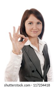 Perfect business woman showing OK hand sign smiling happy isolated on white