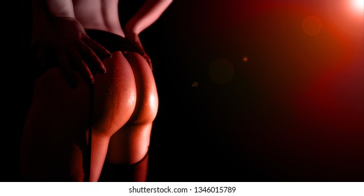 Perfect buttocks in red light effects