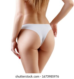 Perfect buttocks of young woman in white panties. Isolated on white background.