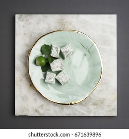 Perfect ceramic plates with golden borders. Plates with sweets and little apples.