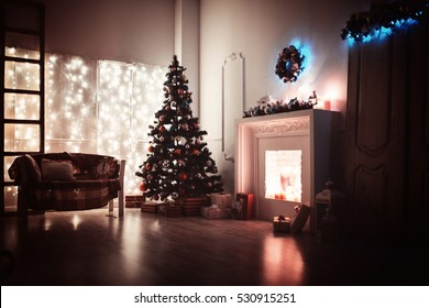 Perfect Christmas tree with decor and fireplace in living room