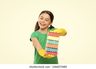 Perfect for cleaning household. Household duties. Little housemaid ready for household help. Small housekeeper holding dish sponges in rubber gloves. Adorable kitchen maid. Cleaning and washing up.