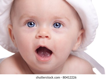 A perfect close up shot of an excited baby.  The baby looks as if she is talking or yelling.