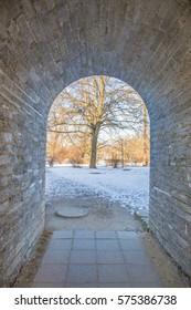 Perfect cobblestone corridor with gateway