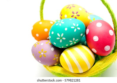 Perfect colorful handmade easter eggs in the basket isolated on a white