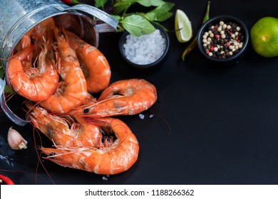 Perfect cooked prawns shrimps with herbs, spices and text space