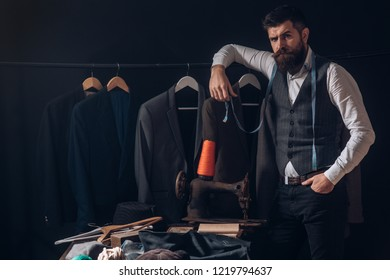 Perfect design. business dress code. Handmade. retro and modern tailoring workshop. suit store and fashion showroom. sewing mechanization. Bearded man tailor sewing jacket. Another client.