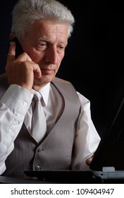 Perfect elderly man in suit on black background