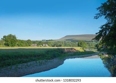 Perfect english countryside view of River Ribble and Pendle Hill in Lancashire, UK