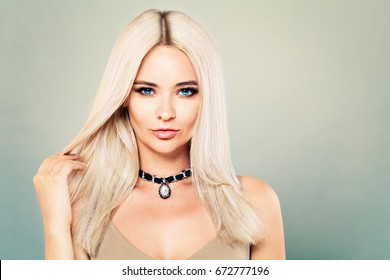 Perfect Fashion Model Girl with Makeup and Blonde Hairstyle on Banner Background