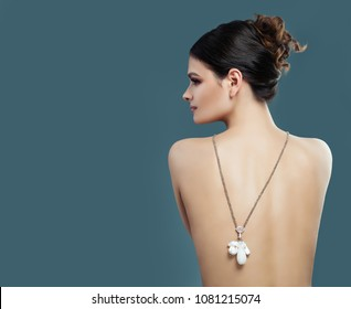 Perfect Fashion Model with Jewelry on Blue Banner Background with Copy space. Female Back, Profile and Jewelry Necklace