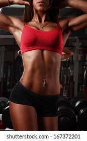 the perfect female body in fitness gym