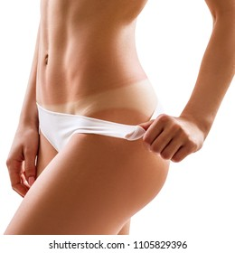 Perfect female buttocks with trail of sunburn. Isolated on white background.