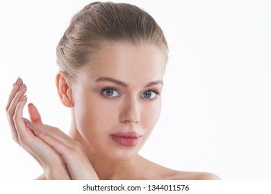 Perfect female face and hands closeup . Healthy Woman . Facial treatment and cosmetology concept
