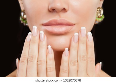 Perfect female hands with manicured nails and lips. French manicure and beige lipstick makeup