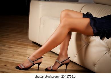 Perfect female legs wearing high heelsheels. Feeling elegant underneath it all