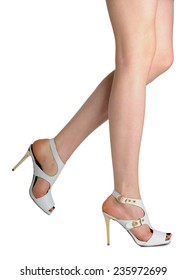 Perfect female legs wearing  high heel shoes isolated on white background.