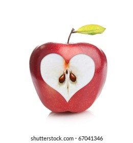Perfect fresh red apple with a heart shaped cut-out on white background