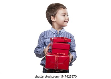 Perfect Gifts for Children. Happy Baby Holds Gifts in Hands Looks away. Beautiful Boy Dressed in a Blue Shirt in a Print Cage. Isolated over White Background. Merry Holiday, and Many Gifts.