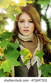 Perfect Girl wearing Lace Scarf in Autumn Park