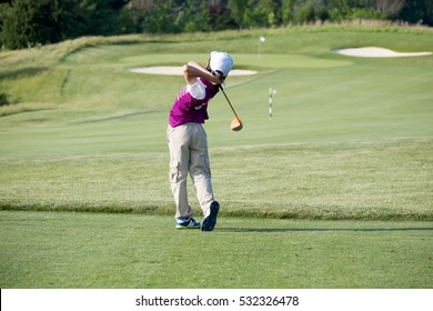 PERFECT GOLF SWING BY A 9 YEARS OLD BOY PLAYING IN JUNIOR LEAGUE GOLF / TEE OFF SHOT WITH DRIVER RIGHT ON MIDDLE OF FAIRWAY / MARYLAND / USA