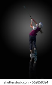 PERFECT GOLF SWING BY A 9 YEARS OLD GIRL PLAYING IN JUNIOR LEAGUE GOLF / ISOLATED ON BLACK BACKGROUND WITH REFLECTION ON GROUND