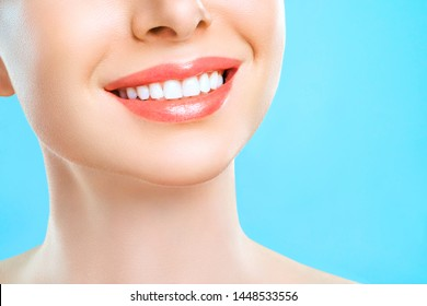 Perfect healthy smile of a young woman. Teeth Whitening. Dental Care Concept. Promotional picture for a dental clinic.