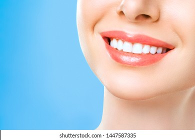 Perfect healthy teeth smile of a woman. Teeth Whitening. Dental health Concept. Promotional picture for a dental clinic.