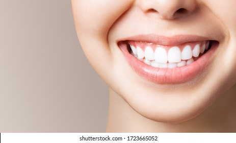 Perfect healthy teeth smile of a young woman. Teeth whitening. Dental clinic patient. Image symbolizes oral care dentistry, stomatology. Dentistry image