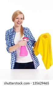 Perfect housewife cleaning the stain with shirts