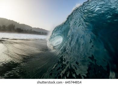 perfect island wave crashing onto hawaii reef