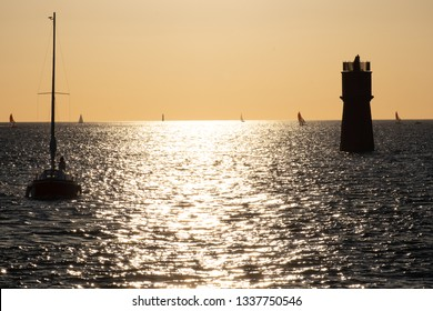 Perfect Juxtaposition of a ship and a tower in the atlantic ocean in La Rochelle France and the light beetwen