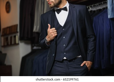 Perfect to the last detail. Extravagant stylish man in tailor studio. Men's beauty, fashion.