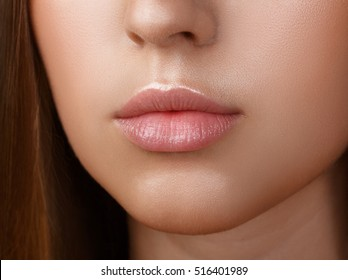 Perfect lips. Sexy girl mouth close up. Beauty young woman Smile. Natural plump full Lip. Lips augmentation. Close up detail