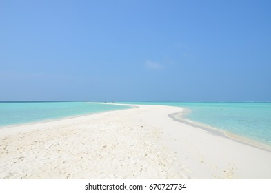 Perfect lonely beach in Maldives island with blue sky and white sand