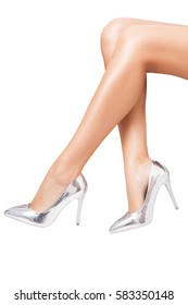 Perfect luxury shoes on elegant legs over white background. Fashion women